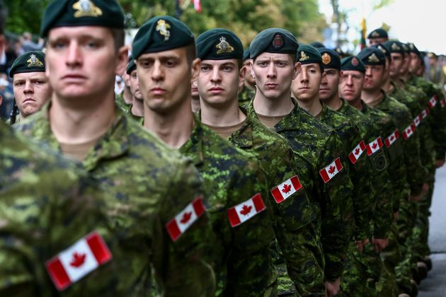 Members of the Canadian Armed Forces are seen here marching during a national Polish holiday in Warsaw...