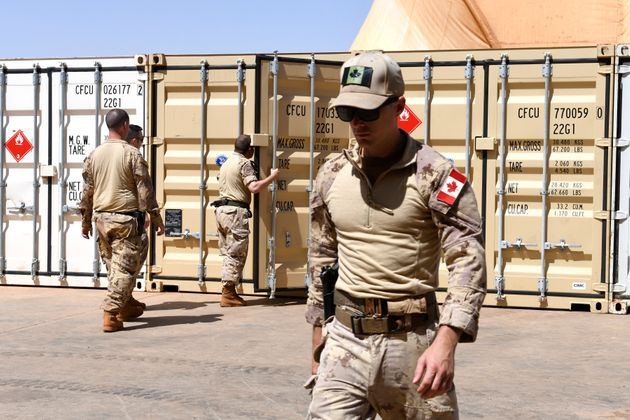 Canadian soldiers involved in the UN peacekeeping mission in Mali unloads material in Gao on Aug. 4,