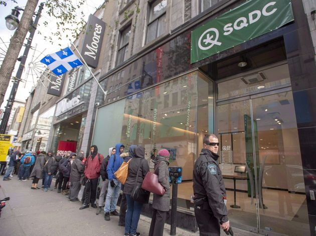 Quebecers line up outside a cannabis store in Montreal on Oct. 18, 2018. New provincial legislation will...