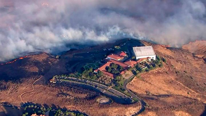 The Ronald Reagan Presidential Library as flames from the Easy fire approach in Simi Valley, Calif., Wednesday, Oct. 30, 2019