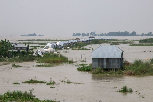 Flooded homes along the Padma River in Goalanda, Bangladesh, in September. Millions of people across...