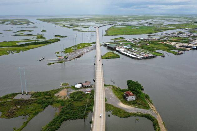 The Louisiana Highway 1 Bridge rises above the marshland and coastal waters of Leeville, Louisiana, in...