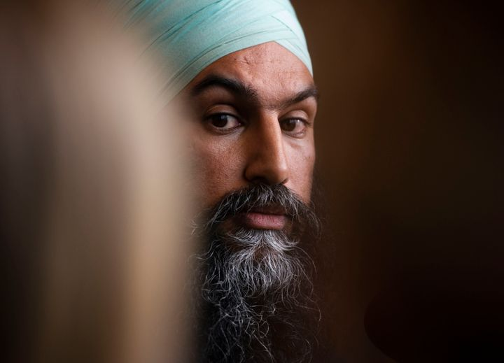NDP leader Jagmeet Singh listens to a question as he holds a press conference following a meeting with his caucus in Ottawa on Oct. 30, 2019.