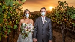Couple Poses With Face Masks In Haunting Wedding Photo Backed By California