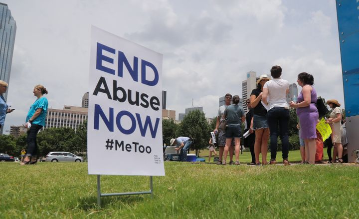 Protesters engage passers-by outside the Southern Baptist Convention on June 12, 2018, in Dallas.
