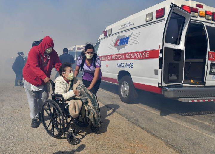Elderly residents of the Riverside Heights Healthcare Center in Jurupa Valley, Calif., are evacuated from their care facility