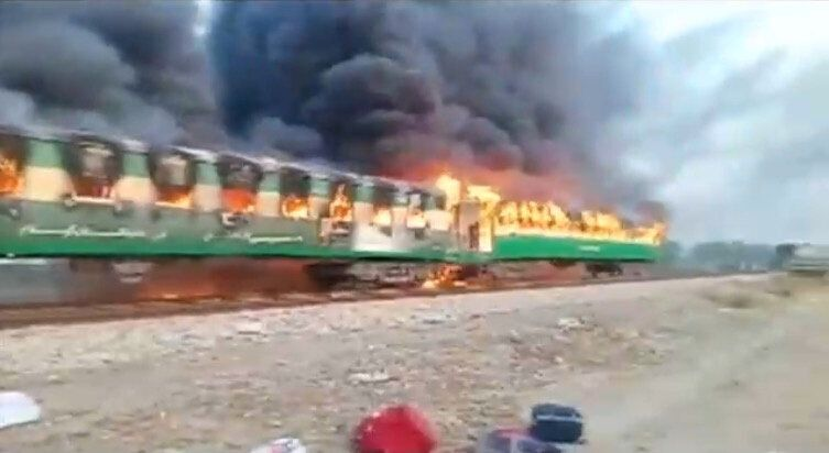 Flames roared through the train cars as the train approached the town of Liaquatpur in Punjab