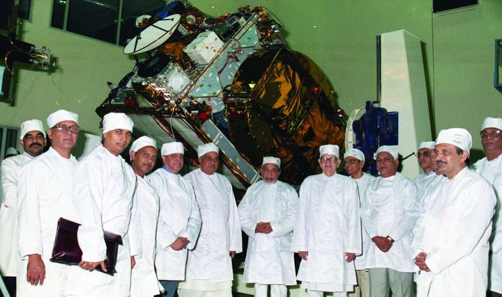 Prime Minister AB Vajpayee seen against the background of the fully integrated INSAT-2E.