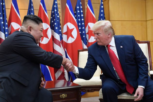 FILE - In this June 30, 2019, file photo, U.S. President Donald Trump, right, meets with North Korean...