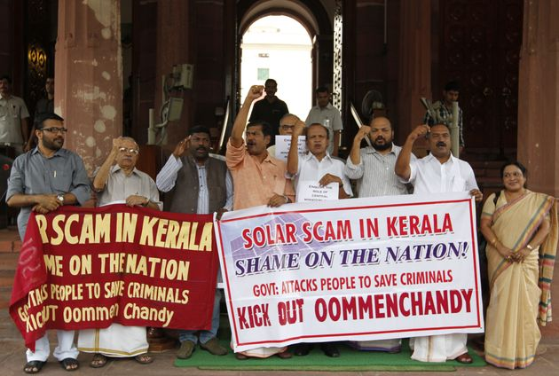 MPs from Kerala protesting at Parliament House against the Solar Scam in Kerala during Monsoon session...