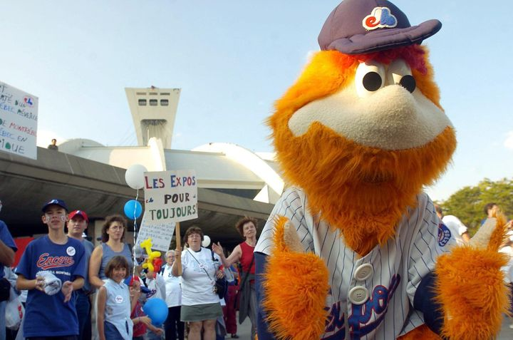 Expos fans cheer with team mascot Youppi! before a game against the Philadelphia Phillies in Montreal on Sept. 25, 2004.