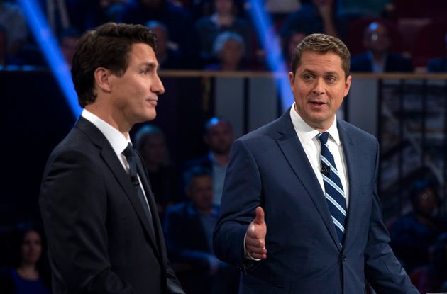 Conservative Leader Andrew Scheer, right, makes a point with Liberal Leader Justin Trudeau during a federal...