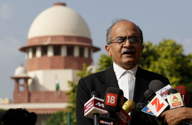 Senior Lawyer Prashant Bhushan speaks to the journalists outside the Supreme Court in New Delhi in this...