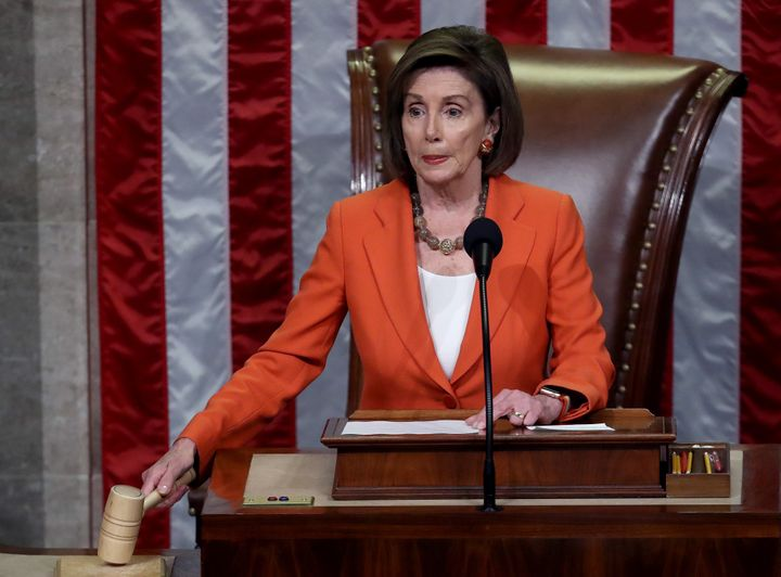 U.S. House Speaker Nancy Pelosi gavels the close of a vote by the U.S. House of Representatives on a resolution formalizing the impeachment inquiry focused on U.S. President Donald Trump on Thursday in Washington, D.C.