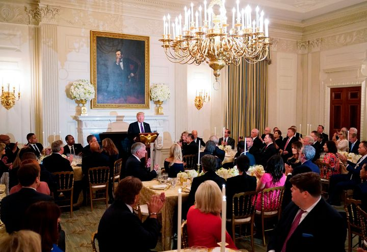 President Donald Trump speaks at an event honoring evangelical leadership in the State Dining Room of the White House on Augu