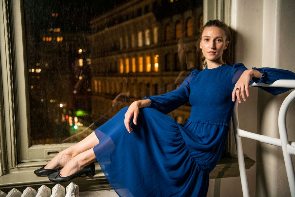 "Teuscher poses in her evening wear, a blue dress from <a href=""https://www.aritzia.com/us/en/clothing/dresses"" target=""_blank"" rel=""noopener noreferrer"">Aritzia</a> with <a href=""https://www.repetto.com/us/women/women-shoes/ballerinas.html"" target=""_blank"" rel=""noopener noreferrer"">Repetto</a> black ballet flats."
