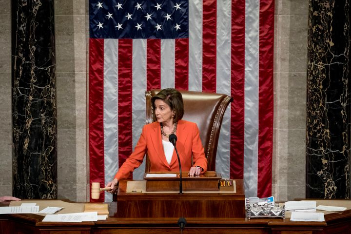 House Speaker Nancy Pelosi wields the gavel Thursday as the House votes 232-196 to pass a resolution allowing the impeachment