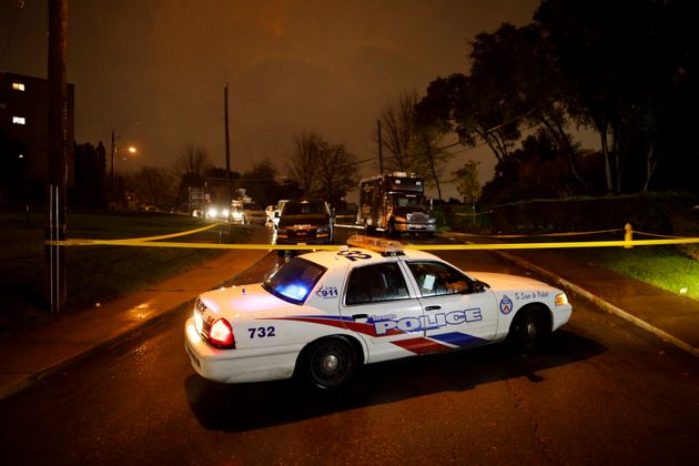 Toronto Police officers cordoned off an area around an apartment building in Toronto on