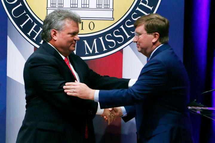 Democratic Mississippi Attorney General Jim Hood, left, and Republican Lt. Gov. Tate Reeves, right, shake hands at the conclu