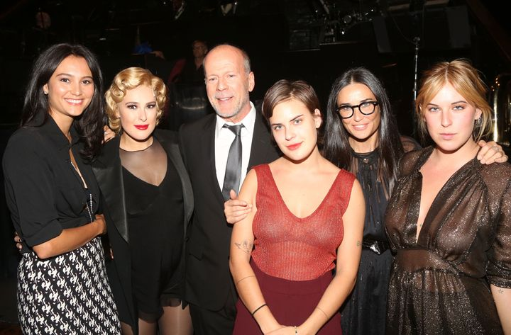 Emma Heming, Rumer Willis, Bruce Willis, Tallulah Willis, Demi Moore and Scout Willis pose backstage as Rumer makes her debut