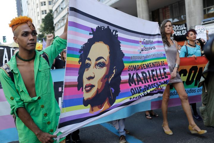 Protesters carry the image of slain councilwoman Marielle Franco in Rio de Janeiro on Sept. 7, 2019.