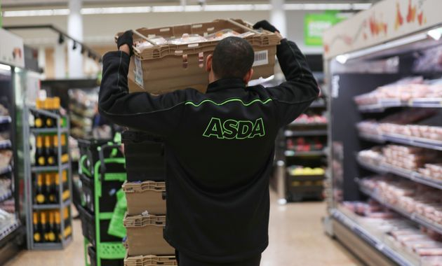 An employee stocks shelves at the Asda superstore in High Wycombe, Britain, February 8, 2017. REUTERS/Eddie