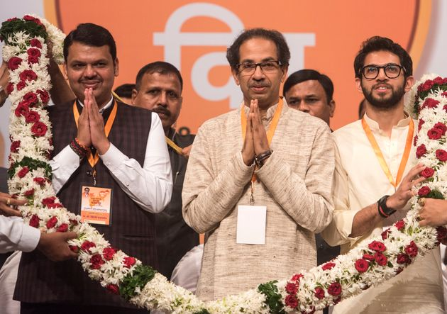 Devendra Fadnavis with Shiv Sena chief Uddhav Thackeray and his son Aditya Thackeray in a file