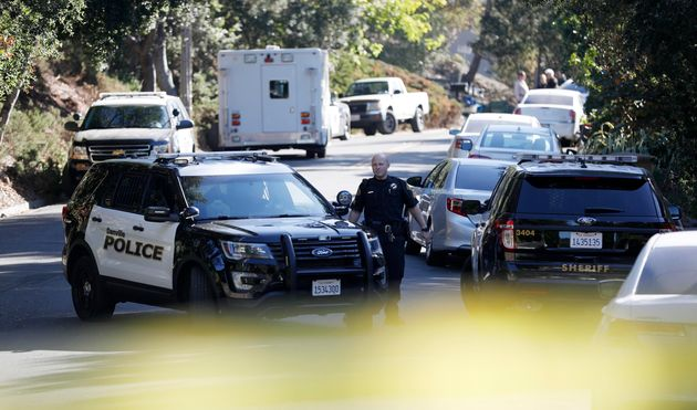 A policeman communicates with his colleague at a shooting site on Nov. 1, 2019 in Orinda,