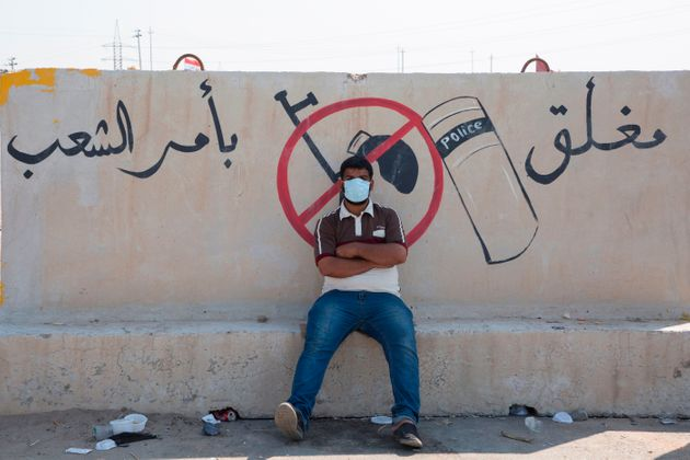 TOPSHOT - Iraqi protesters block the highway leading to Umm Qasr port during ongoing anti-government...