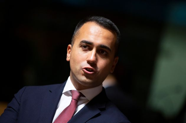 Italian Foreign Minister Luigi Di Maio, center, waits for the start of a meeting of EU foreign ministers...