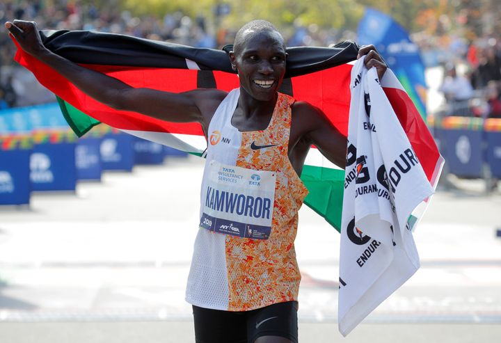 Kenya's Geoffrey Kamworor celebrates winning the elite men's race on Sunday.