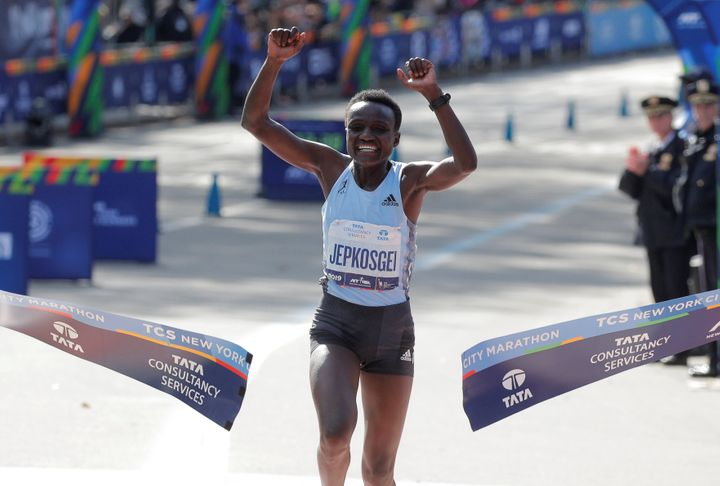 Kenya's Joyciline Jepkosgei crosses the line to win the women's elite race.