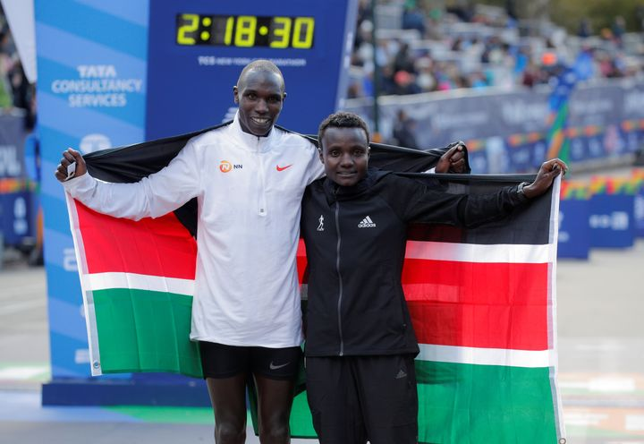 Kenya's Geoffrey Kamworor and Kenya's Joyciline Jepkosgei pose as they celebrate winning the men's and women's elite races re