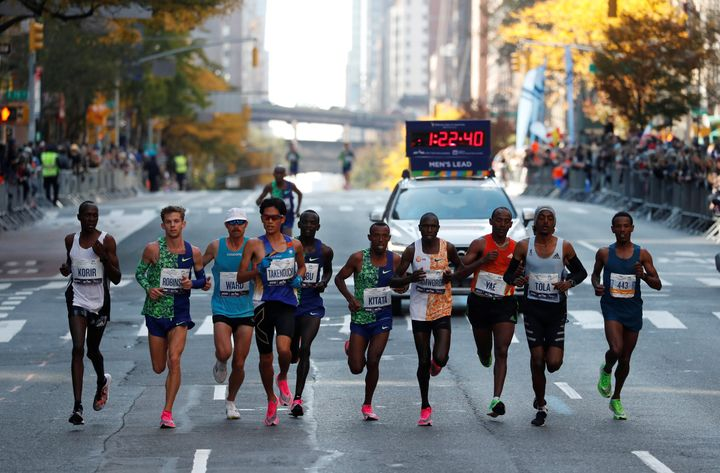 Kenya's Geoffrey Kamworor and the rest of the leading pack in action during the elite men's race.