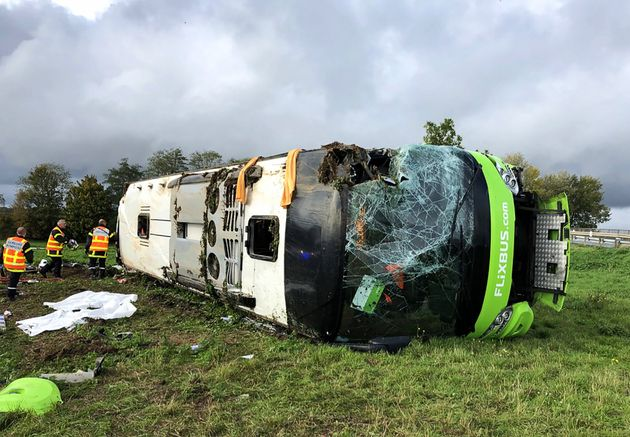 Emergency services are at work on the site of an accident after a bus from the Flixbus company