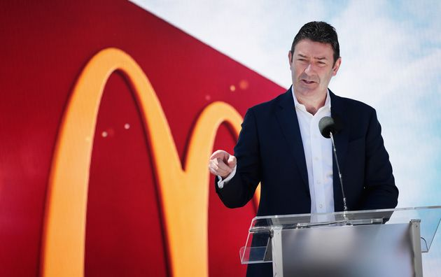 McDonald's CEO Steve Easterbrook unveils the company's new corporate headquarters during a grand opening...