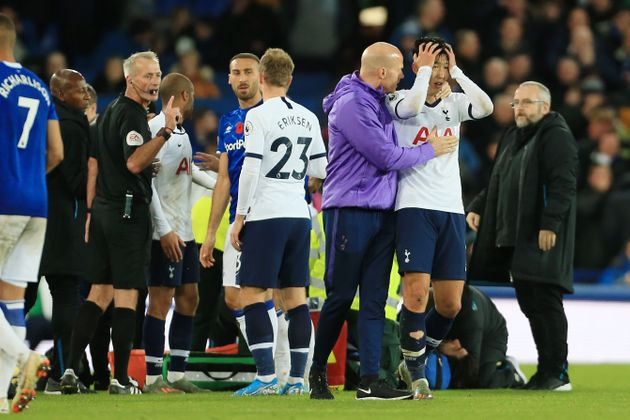 LIVERPOOL, ENGLAND - NOVEMBER 03: Son Heung-Min of Spurs is consoled following his foul on Andre Gomes...