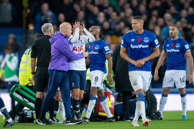 LIVERPOOL, ENGLAND - NOVEMBER 03: Son Heung-min of Tottenham Hotspur reacts to Andre Gomes injury during...