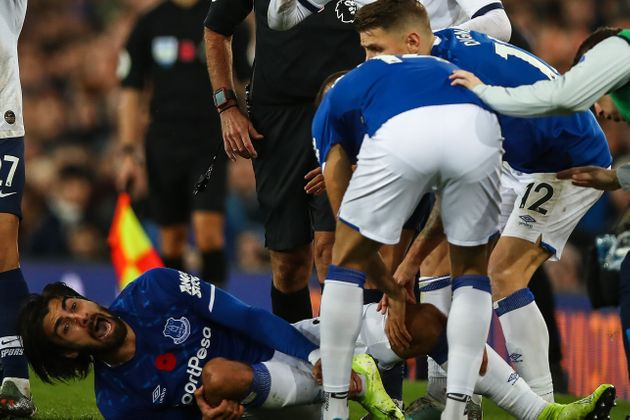 LIVERPOOL, ENGLAND - NOVEMBER 03: Andre Gomes of Everton reacts in pain after a tackle from Son Heung-min...