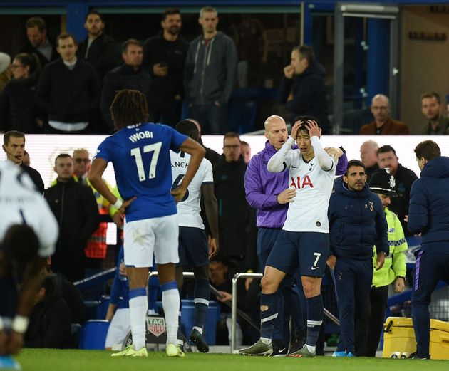 Tottenham Hotspur's South Korean striker Son Heung-Min (C) reacts after his involvement in an incident...