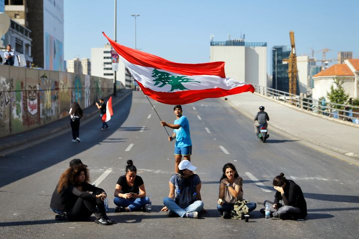 Anti-government protesters block a main highway in Beirut, Lebanon, Monday, Nov. 4, 2019.