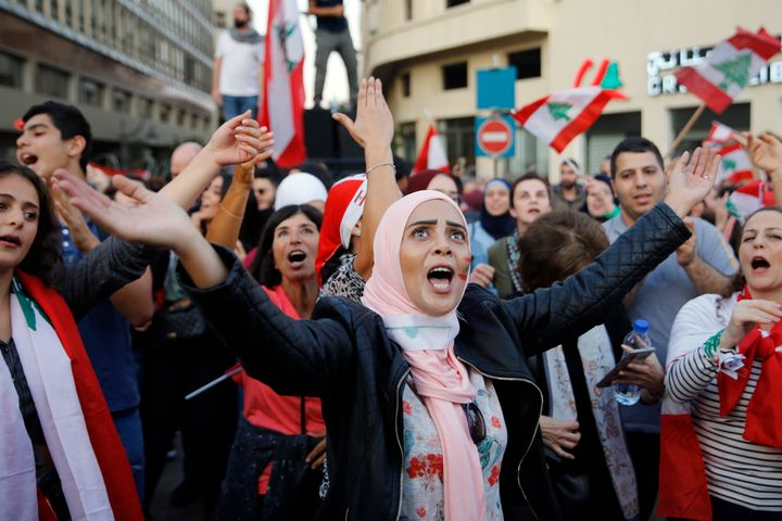 Anti-government protesters chant slogans against the Lebanese government, in Beirut, Lebanon, Sunday, Nov. 3, 2019.