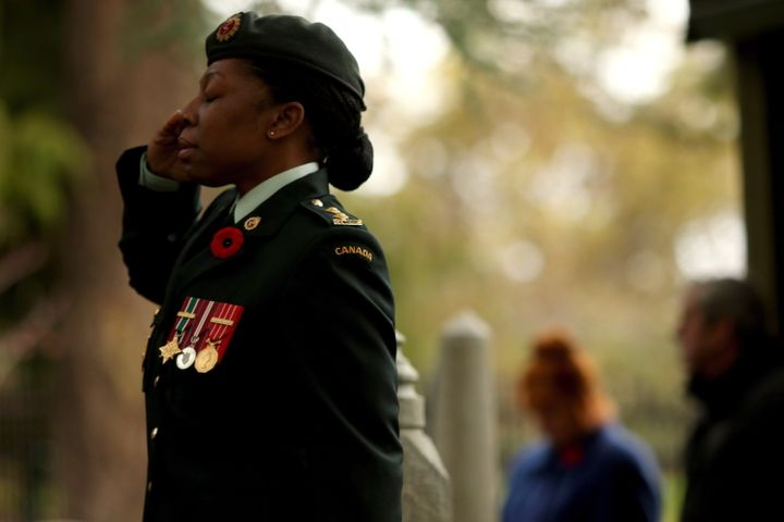 Lieutenant Kerry-Ann Cameron salutes during Remembrance Day ceremony at God's Acre Veteran's Cemetery in Victoria, B.C., on Nov. 11, 2018.