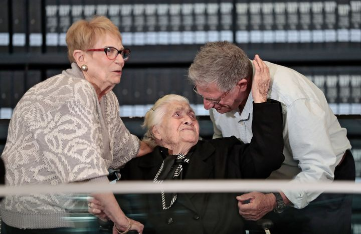 Melpomeni Dina, center, is reunited with Holocaust survivors Yossi Mor, right, and his sister Sarah Yanai at the Yad Vashem H