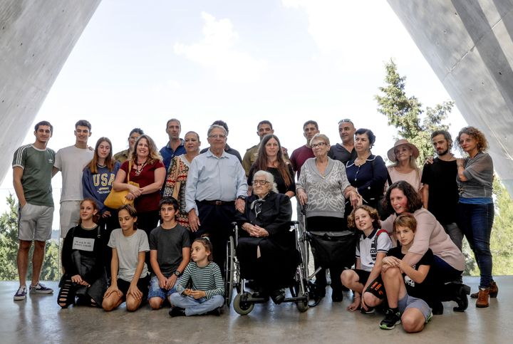 Dina poses for a group photo with the descendants of the Mordechai family, whom she helped save during the Holocaust.