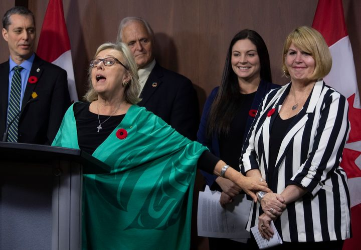 Green MP Paul Manly, left, John Kidder, and Green MP Jenica Atwin look on as party leader Elizabeth May announces Jo-Ann Roberts as the interim party leader during a news conference in Ottawa on Nov. 4, 2019.