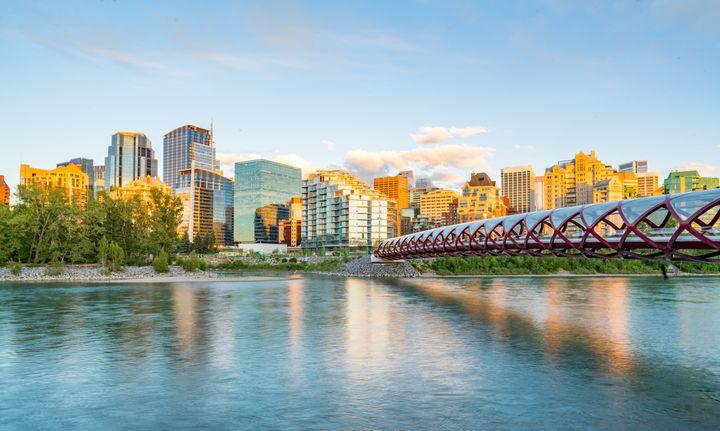 Skyline of the city Calgary, Alberta, Canada along the Bow River with Peace Bridge
