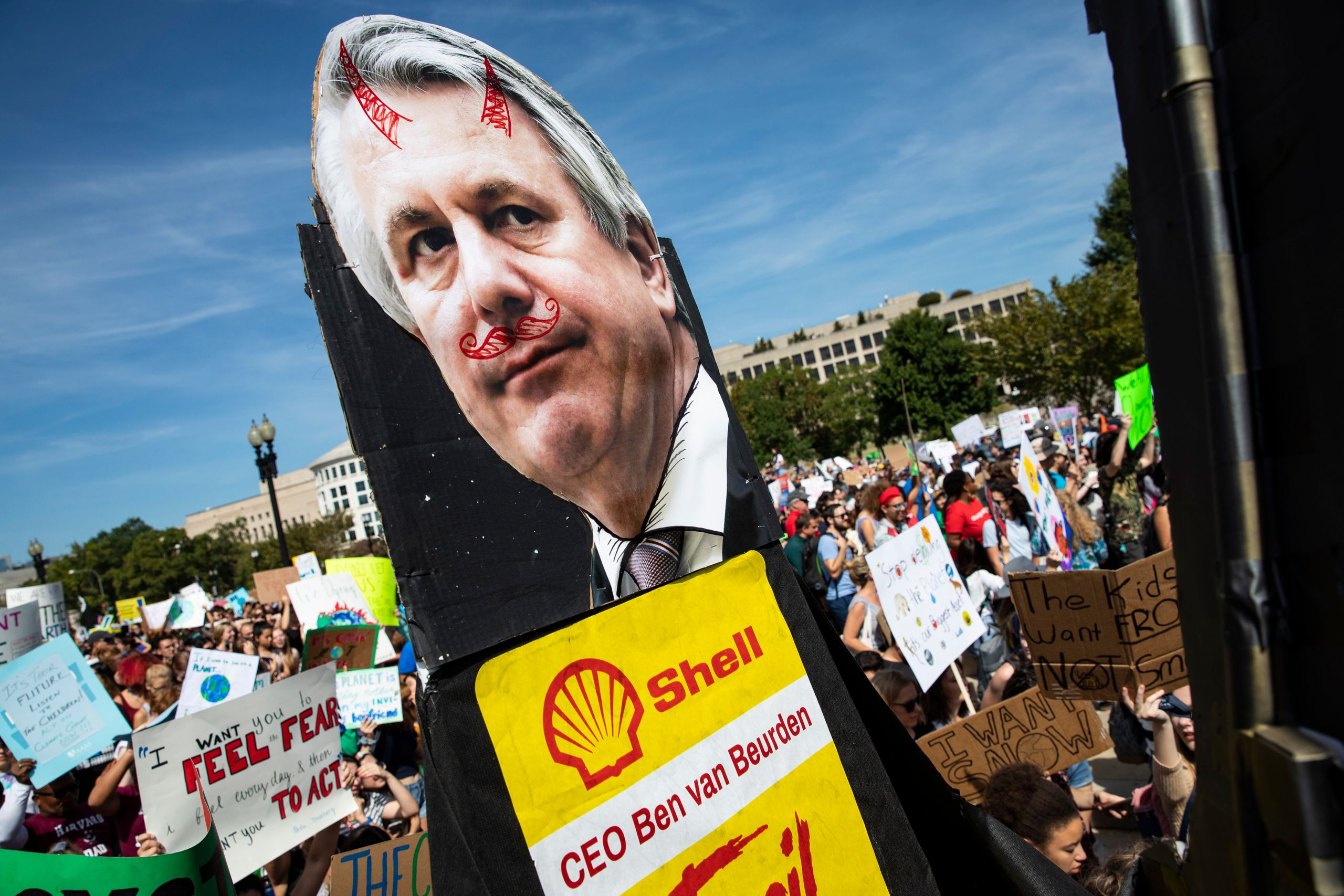 Youth carry along an effigy of Shell CEO Ben van Beurden for the Global Climate Strike protests on September 20, 2019 in Wash
