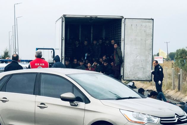 Migrants are seen inside a refrigerated truck found by police, after a check at a motorway near