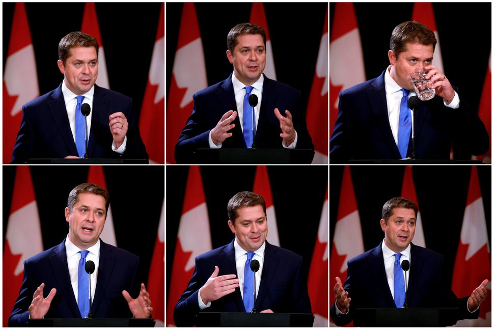 A combination picture shows Conservative Leader Andrew Scheer speaking at a news conference the day after...